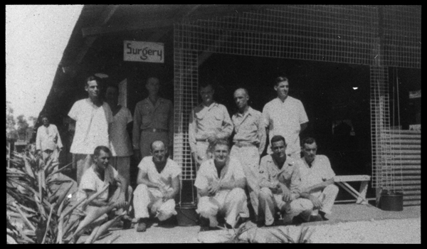 Group of men outside of the Surgery building at U.S. Army, 27th General Hospital site.