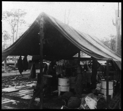 Exterior shot of a tented outdoor platform with mechanical washing machines